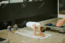 weightloss group plank workout for abs women fitness weightloss group stock photo