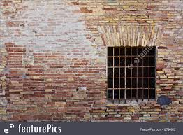 architectural details old ruined brick wall with square window