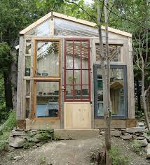 26 asymmetrical salvaged wood and window greenhouse