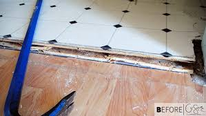 the painstaking process of how we took up the old linoleum floors in our