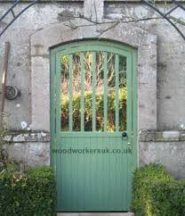 entrance to a walled garden with wooden gate