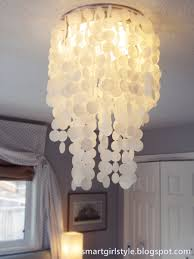 wonderful white capiz shell chandelier on white ceiling matched with lavender wall for bedroom decor ideas