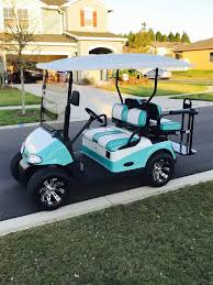 the shelby blue custom painted with eleanor cross stitch seat covers even the thread matches the color golf cart