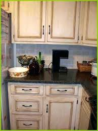 distress white cabinets distressed