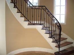 ... Wrought Iron Hand Railing Wrought Iron Step Railing Arched Corner  Staircase With Dark Wood ...