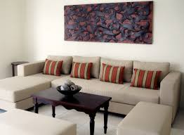 Exotic living room furniture Red Wall Decoration And Accessories Living Room Interior Design With Bali Furniture Style Light Brown Shape Sofa With Stripe Comfy Cushion And Colonial Table Zenwillcom Decoration And Accessories Living Room Interior Design With Bali