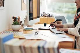 Graphic Designer At Desk 10 Reasons Why Its An Ideal Time To Study Graphic Design