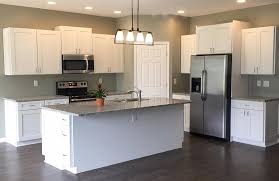 white kitchen cabinets with green backsplash