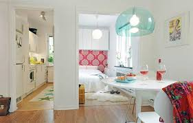 Beautiful and Practical Tiny Apartment Interior Design Shop this look: shag  rug, table, comforter.