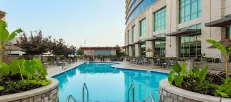 outdoor pool and side of hotel