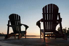adirondack chair silhouette.  Silhouette Silhouette Of Adirondack Chairs On A Wooden Dock Along Lake At Sunset  Ontario Canada With Adirondack Chair