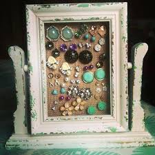 my own stud earring holder made from a picture frame burlap