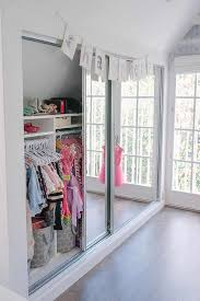 well organized kid closet with mirrored doors view full size