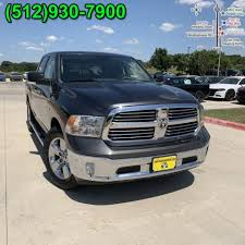 PRE-OWNED 2015 RAM 1500 LONE STAR RWD CREW CAB PICKUP