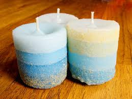 candle cast in molds made from wet sand