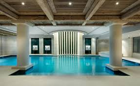 View in gallery Beautifully lit indoor pool in luxurious French Chalet