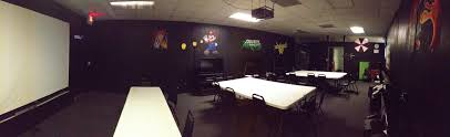 In Vogue White Rectangle Table Added Black Chair Set As Well As Black Wall  Painted And Ceiling Projector In Basement Video Game Room Ideas