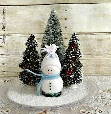 a cute diy wooden snowman in a snow
