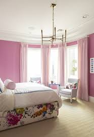A bright, sassy pink paint color creates festive and fun environment. The  bright pink walls ...