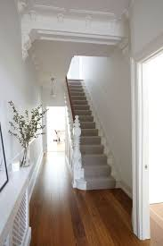 white staircase with runner very clean with the wooden floor gives a contemporary feel to a victorian house