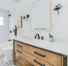 the new hall bathroom features agdal black cement floor tiles from moroccan mosaics a vanity