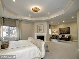 Master Bedroom Traditional Traditional Master Bedroom With Stone Fireplace Carpet Zillow