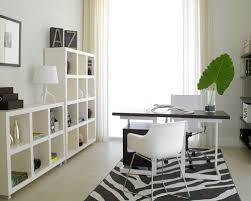 modern office storage. inspiration for a modern freestanding desk home office remodel in miami with white walls storage