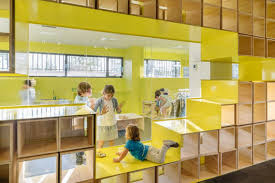 Walls With Integrated Furniture And Yellow Nooks Encourage Play In Fascinating Furniture Design Schools