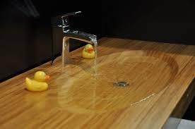 oval integral wood sink in edge grain wood countertop