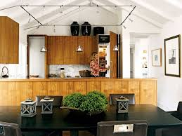 Vaulted Ceiling Decor With Square Track Lighting And Wood Pallet
