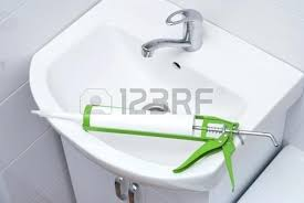 sanitary silicone sealant against the background of a sink in bathroom stock photo drain si post bathroom sink sealant