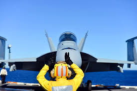 u s department of defense photo essay  u s navy chief petty officer edward zapanta directs an f a 18f super hornet