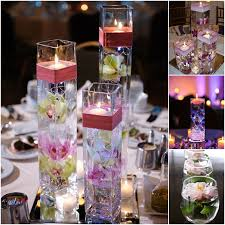 VIEW IN GALLERY Floating-candle-centerpiece