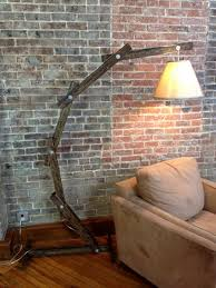 14 articulated wooden floor lamp using salvaged wood pieces