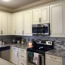 consider these tips and tricks to work around cabinets windowore for a finished look in your kitchen wondering where to end your backsplash