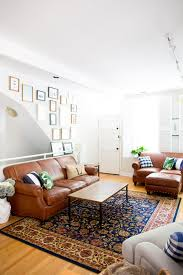 if you ve been itching to try out a gallery wall the living room is the perfect place to hang it collect an assortment of frame sizes and hang with your