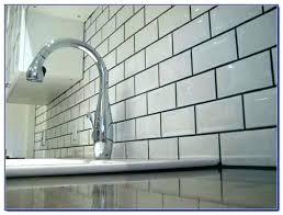 light gray glass subway tile grey grout white dark and floor g