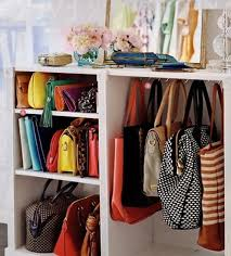 turn a bookshelf into a purse cubby by adding hooks for tote bags and lining up clutches on shelves