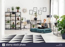 office futon. Girl In Glasses Sitting On A Futon Mattress And Reading Book Bright Interior With Office M