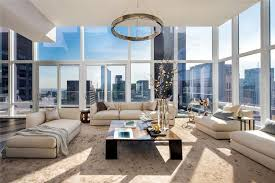 contemporary living room with drum chandelier and amazing city views