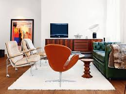 mid century modern living room ideas. living room. green and white leather sofa orange chair on fur rug plus mid century modern room ideas t