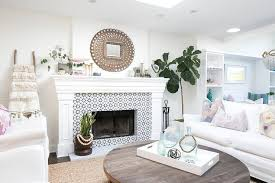 pea mirror over fireplace with black and white tiles