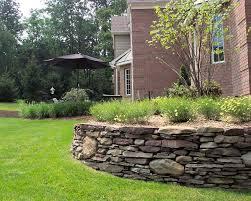 pennsylvania fieldstone retaining wall creates new planting area watchung nj
