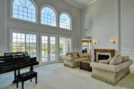 the formal living room boasts classy sofa set near the fireplace