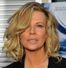 blonde wavy hairstyle this hairstyle looks quite youthful and is the best option for women over 50