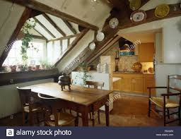 Attic Kitchen Simple Pine Table And Chairs In Attic Kitchen Dining Room Stock