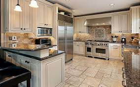should kitchen cabinets or flooring be