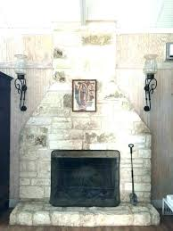 river rock fireplace painted white painted rock fireplace white rock fireplace full floor to ceiling white