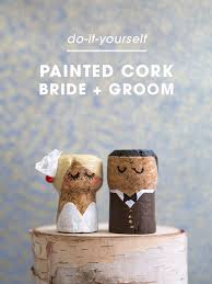 these diy champagne cork bride and groom cake toppers are the cutest thing ever