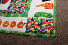 very hungry caterpillar quilt & I did change the fabric they suggested for the border instead using the  co-ordinating green fabric from the Eric Carle by Andover Fabrics range (in  the ... Adamdwight.com